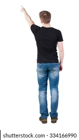 Back view of  pointing young men in  t-shirt and jeans. Young guy  gesture. Rear view people collection.  backside view of person.  Isolated over white background.