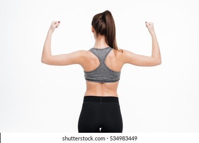 Back view portrait of a fitness woman showing her biceps isolated on a white background