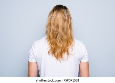 Back view portrait of young man clothed in white tshirt, he has perfect, shiny blonde long healthy hair, isolated on grey background
