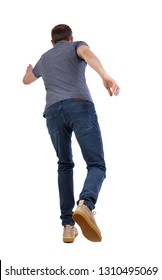 back view of running  man. backside view of person.  Rear view people collection. Isolated over white background. A young guy in yellow shoes runs ahead.