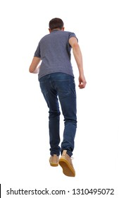 back view of running  man. backside view of person.  Rear view people collection. Isolated over white background. A young guy in yellow boots crouches down into the distance.