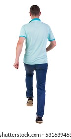 Back view of running man in blue polo. Walking guy in motion. Rear view people collection. Backside view of person. Isolated over white background.