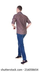 Back view of running man in brown shirt. Walking guy in motion. Rear view people collection. Backside view of person. Isolated over white background.
