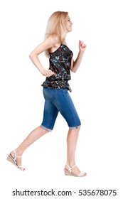 back view of running  woman. beautiful blonde girl in motion. backside view of person.  Rear view people collection. Isolated over white background.