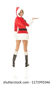 Back view of santa woman holding something invisible on the right hand.