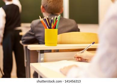 Back view of schoolchildren studying in the school