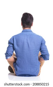 back view of a seated young brunette man , on white background