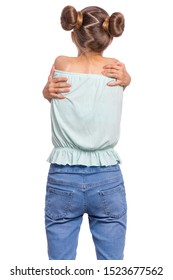Back view. Self love and self care. Portrait of teen girl Hugging oneself, isolated on white background. Cute caucasian young teenager. Happy funny child - rear view.