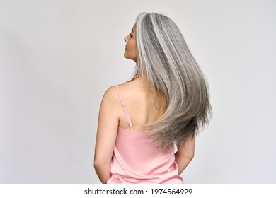Back view of senior mature middle aged older Asian lady with long gray natural coloring vibrant silky hair. Dry hair replenishing healing treatment for women after menopause advertising concept. - Shutterstock ID 1974564929