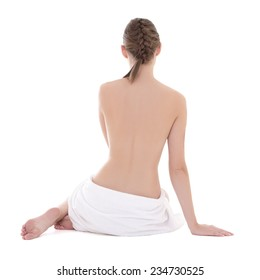 back view of sexy woman sitting with towel isolated on white background