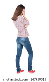 Back view of shocked woman in blue jeans. upset young brunete girl. Rear view people collection.  backside view of person.  Isolated over white background.