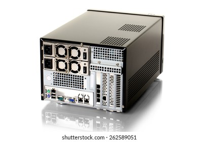 Back view of a small modern computer on a white background.