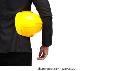 back view of smart businessman in formal suit and holding yellow safety helmet isolated on white background with clipping path