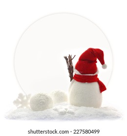Back view of snowman and Christmas ornaments in front of a paper card