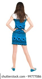 back view of standing beautiful brunette woman. Young girl in blue dress . Rear view. Isolated over white background