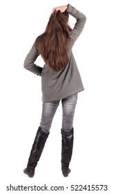 back view of standing young beautiful woman. brunette girl in jeans and coat watching . Rear view people collection. backside view of person. Isolated over white background.