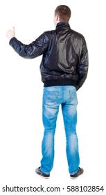 back view of standing young  man showing thumb up.  guy gesturing ok sign. Rear view people collection.  backside view of person.  Isolated over white background