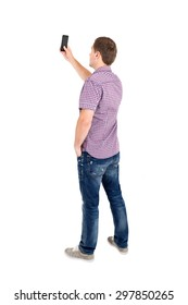 Back view of standing young men and using a mobile phone. Rear view people collection. Backside view of person. Isolated over white background