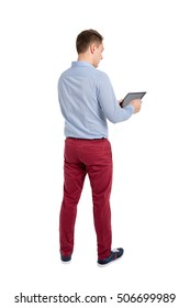 Back view of standing young men and using a tablet. Backside view of person. Isolated over white background