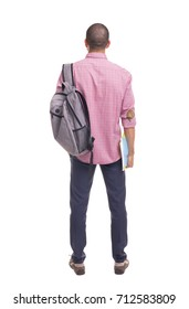 Back view of a student standing with textbooks and backpack on white background