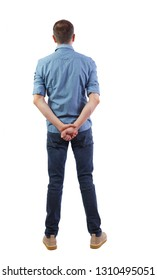 Back view of a stylish man. Rear view people collection.  backside view of person.  Isolated over white background. A man in a shirt is standing with arms folded behind his back.