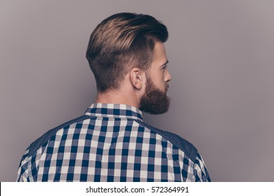 Back view of stylish  young bearded man with modern hairstyle.