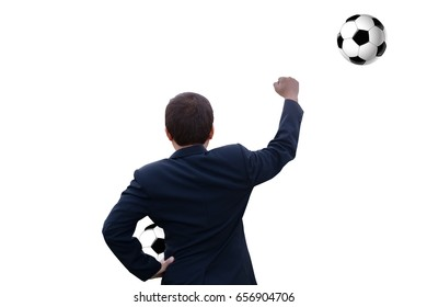 Back view of successful business man arms up with football