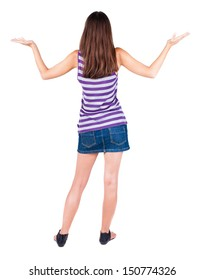 back view of surprised beautiful brunette young woman with hands up. Girl in blue dress. Rear view people collection.  backside view of person.  Isolated over white background.