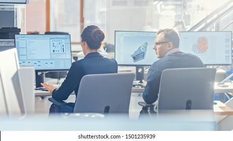 Back View of Team of Technology Engineers Working on Desktop Computers in Office. Screens Show IDE / CAD Software, Implementation of Machine Learning, Neural Networking and Cloud Computing