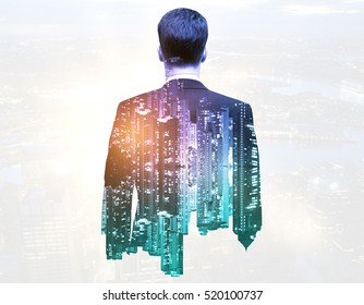Back view of thoughtful businessman on night city background. Double exposure. Research concept
