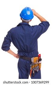 Back view of a thoughtful worker standing on a white background