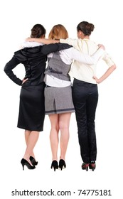 Back view of  three beautiful young business woman looking at wall. Rear view. Isolated over white.