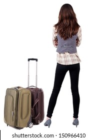 Back view of traveling brunette woman in jeans with suitcase looking up. Standing young girl. Rear view people collection.  backside view of person. Isolated over white background.