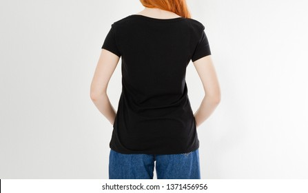 back view t-shirt design, happy people concept - smiling red hair woman in blank black t-shirt pointing her fingers at herself, red head girl tshirt mock up