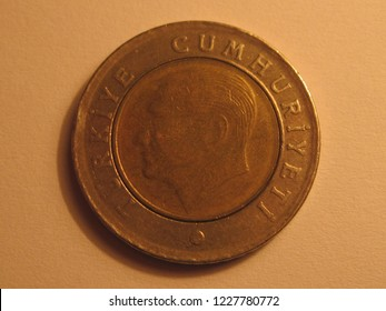 Back view of Turkish coin. 50 kurus from Turkey. Great for numismatic collection. Shiny coin isolated on yellow surface of paper.