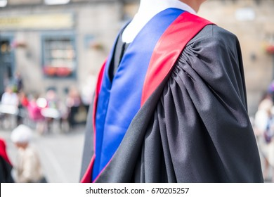 Back view of an unidentified graduate student with blur background of people in commencement day.