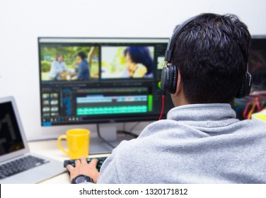 back view of video editor using computer - Image
