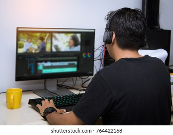 back view of video editor using computer
