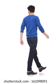 back view of a walking casual man looking to a side on white background