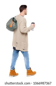 back view of walking  man  with coffee cup and green bag. backside view of person.  Rear view people collection. Isolated over white background.