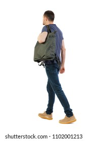 back view of walking  man  with green bag. backside view of person.  Rear view people collection. Isolated over white background. The guy carries a bag on his shoulder with things
