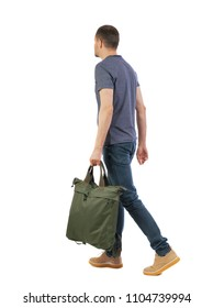back view of walking  man  with green bag. backside view of person.  Rear view people collection. Isolated over white background. The guy is carrying a large bag