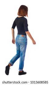 back view of walking  woman. beautiful blonde girl in motion.  backside view of person.  Rear view people collection. Isolated over white background. The girl in a black sweater goes sideways.