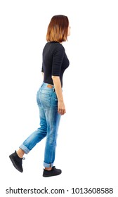 back view of walking  woman. beautiful blonde girl in motion.  backside view of person.  Rear view people collection. Isolated over white background. TThe girl in a black sweater passes by.