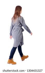 back view of walking woman. beautiful girl in motion. backside view of person.  Rear view people collection. Isolated over white. A girl in a plaid dress passes by.