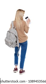 Back view of walking  woman  with coffee cup and backpack. backside view of person.  Rear view people collection. Isolated over white background.  The student drinks coffee