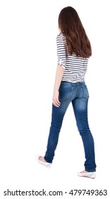 back view of walking  woman in jeans . beautiful brunette girl in motion.  backside view of person.  Rear view people collection. Isolated over white background. The girl in a striped T-shirt with