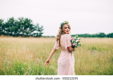 Back View Of A Walking Young Woman In Boho Dress