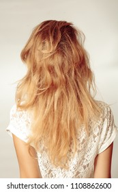 Back view of woman with beautiful long dyed blonde hair