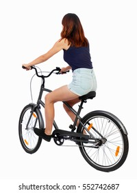 back view of a woman with a bicycle. cyclist sits on the bike. Rear view people collection.  backside view of person. Isolated over white background. Beautiful girl in summer clothes riding a bicycle.